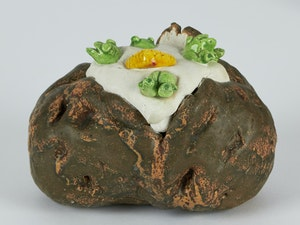 Artwork by David James Gilhooly, A Baked Potato with Butter and Frogs